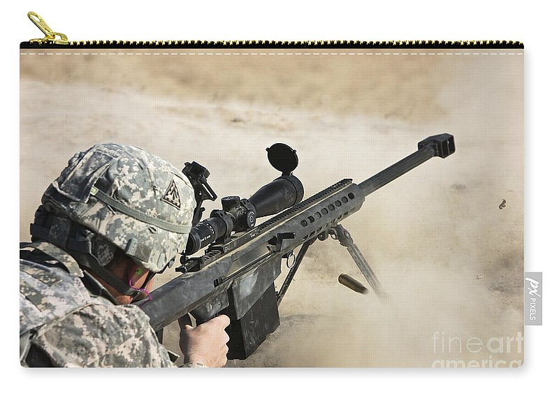 Sniper Carry-all Pouch featuring the photograph U.s. Army Soldier Fires A Barrett M82a1 by Terry Moore