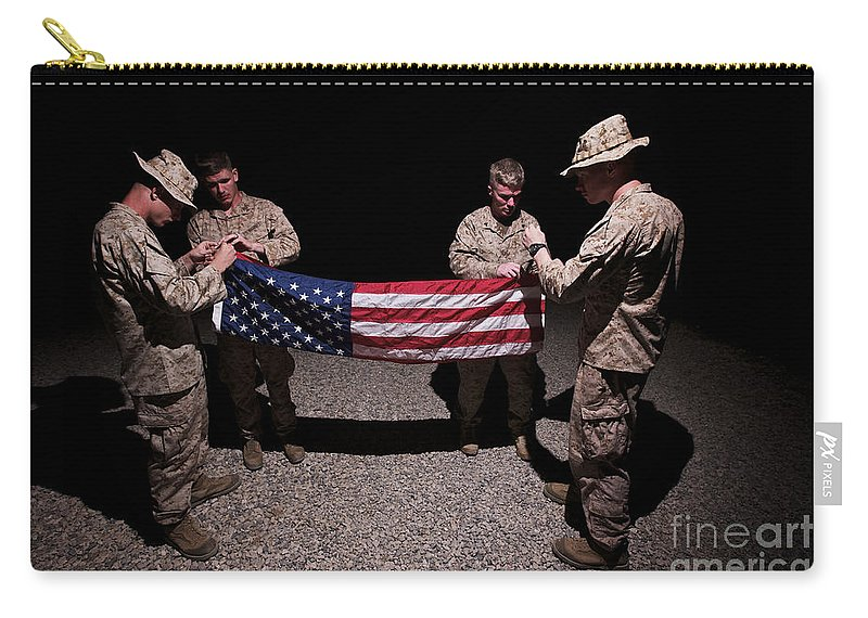 Us Flag Carry-all Pouch featuring the photograph U.s. Marines Fold The American Flag by Terry Moore