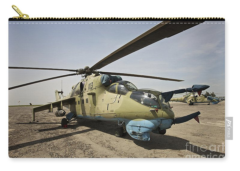 Attack Helicopters Carry-all Pouch featuring the photograph An Mi-35 Attack Helicopter At Kunduz by Terry Moore
