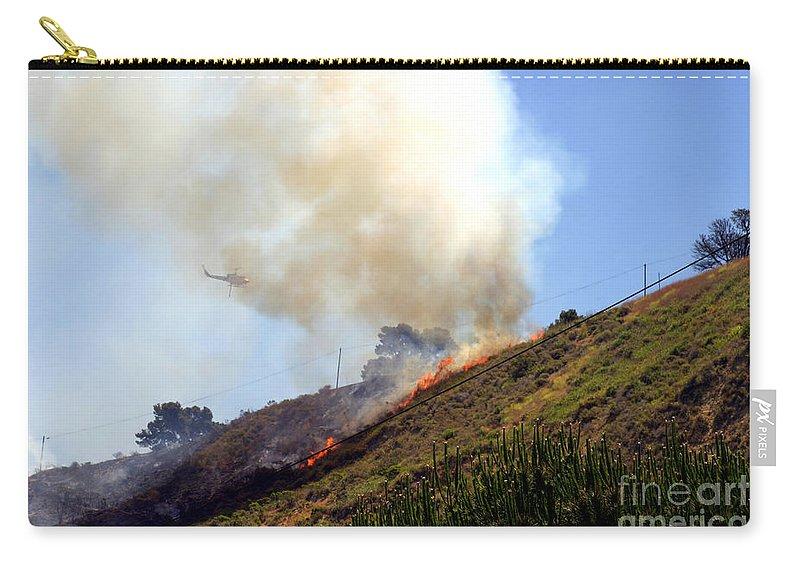 Ash Carry-all Pouch featuring the photograph Barnett Fire by Henrik Lehnerer