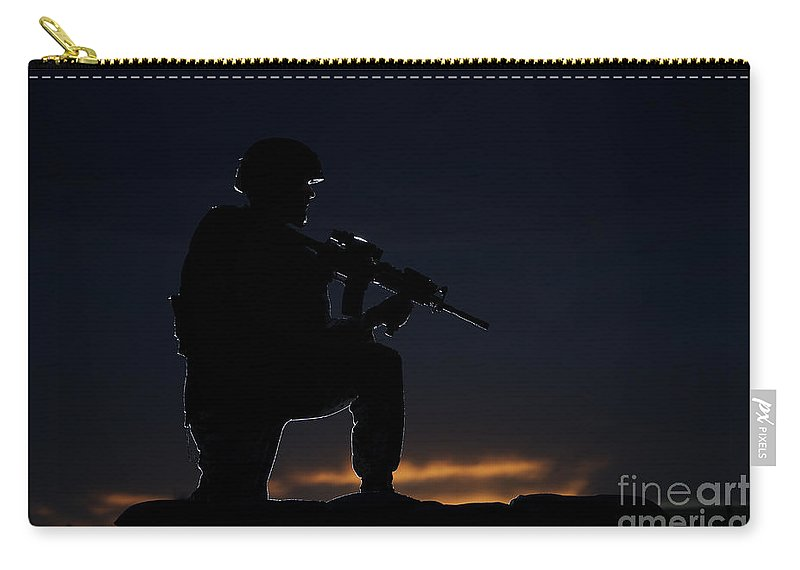 Outdoors Carry-all Pouch featuring the photograph Partially Silhouetted U.s. Marine by Terry Moore