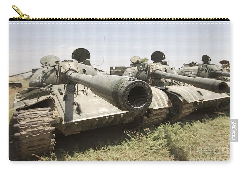 Army Carry-all Pouch featuring the photograph Russian T-54 And T-55 Main Battle Tanks by Terry Moore