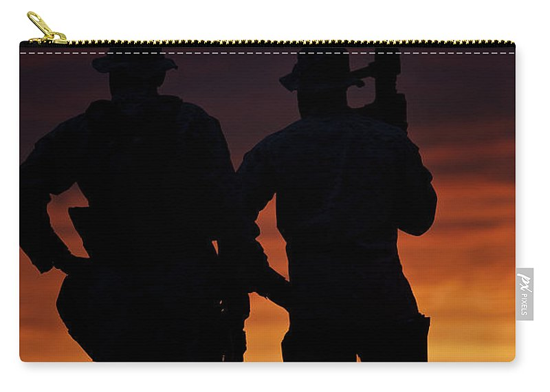 Operation Enduring Freedom Carry-all Pouch featuring the photograph Silhouette Of U.s Marines On A Bunker by Terry Moore