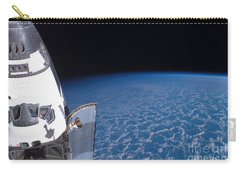 Cloud Carry-all Pouch featuring the photograph Space Shuttle Endeavour by Stocktrek Images