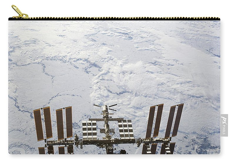 View From Space Carry-all Pouch featuring the photograph The International Space Station by Stocktrek Images