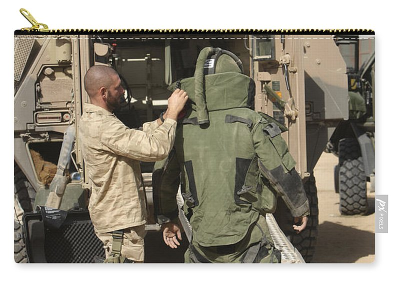 Afghanistan Carry-all Pouch featuring the photograph A U.s. Marine Gets Suited by Terry Moore