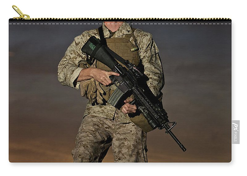 Helmet Carry-all Pouch featuring the photograph Portrait Of A U.s. Marine In Uniform by Terry Moore