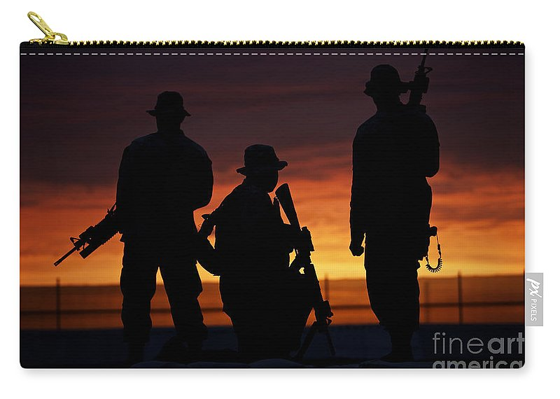 M16 Carry-all Pouch featuring the photograph Silhouette Of U.s Marines On A Bunker by Terry Moore