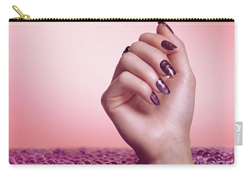 Manicure Carry-all Pouch featuring the photograph Woman Hand With Purple Nail Polish by Oleksiy Maksymenko