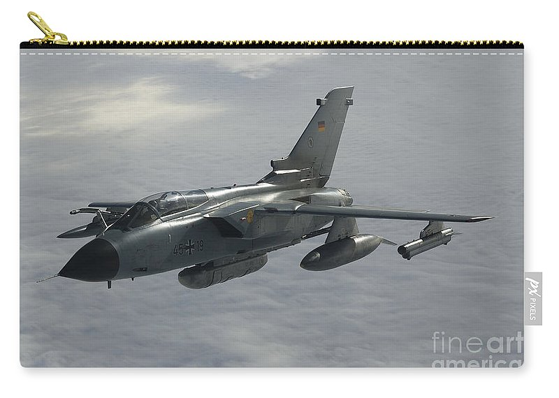 Germany Carry-all Pouch featuring the photograph A Luftwaffe Tornado Ids Over Northern by Gert Kromhout