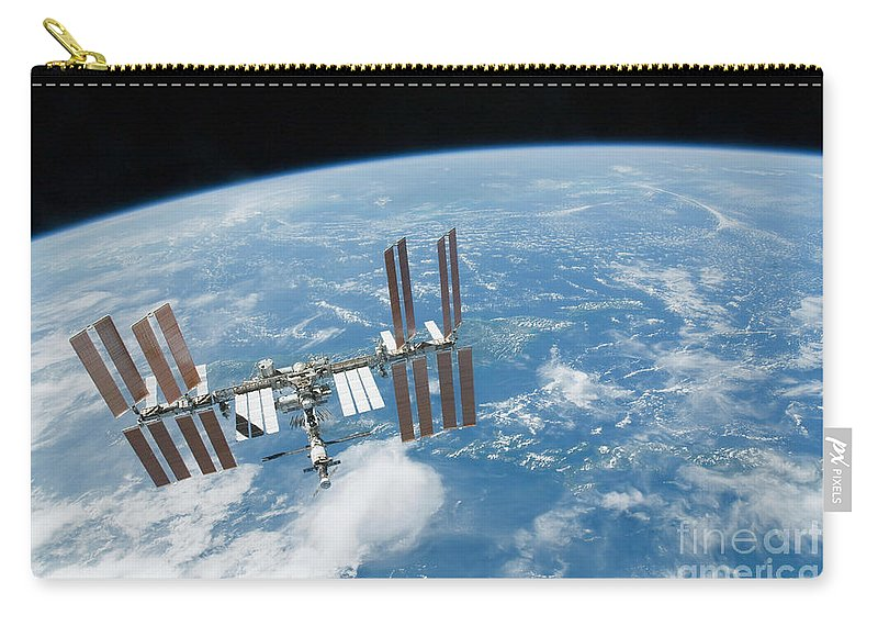 Technology Carry-all Pouch featuring the photograph The International Space Station by Stocktrek Images