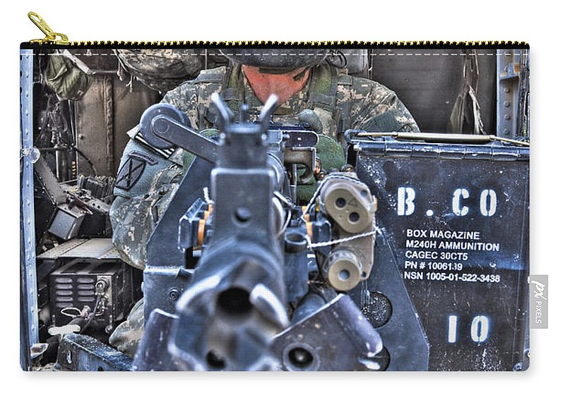 Aviation Carry-all Pouch featuring the photograph Hdr Image Of A Uh-60 Black Hawk Door by Terry Moore