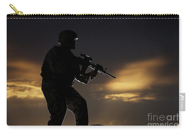 Vigilant Carry-all Pouch featuring the photograph Partially Silhouetted U.s. Marine by Terry Moore