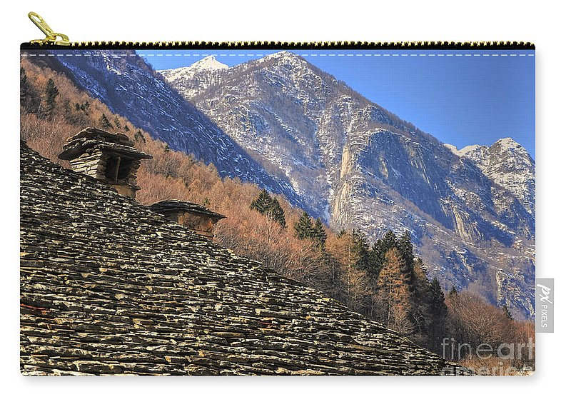 Roof Carry-all Pouch featuring the photograph Snow-capped Mountain by Mats Silvan