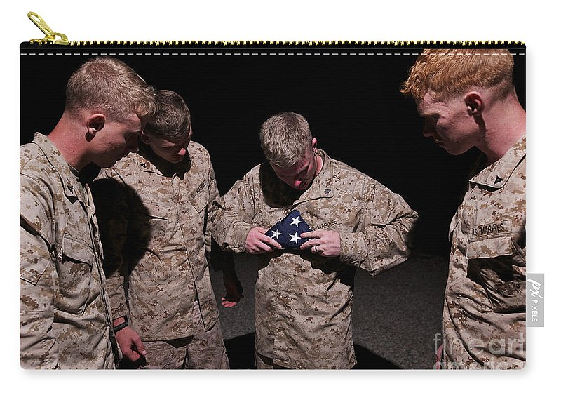 Us Marines Carry-all Pouch featuring the photograph U.s. Marines Fold The American Flag by Terry Moore