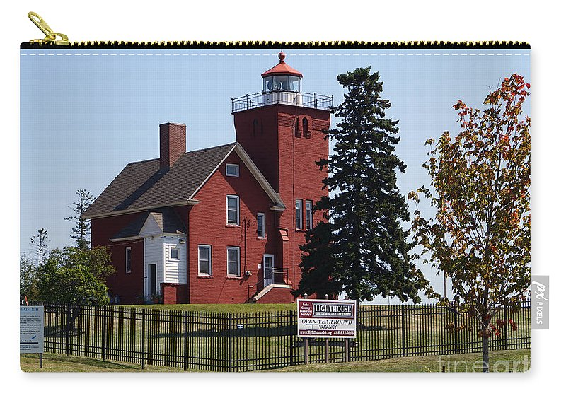 Lighthouses Carry-all Pouch featuring the photograph Lighthouse by Lori Tordsen