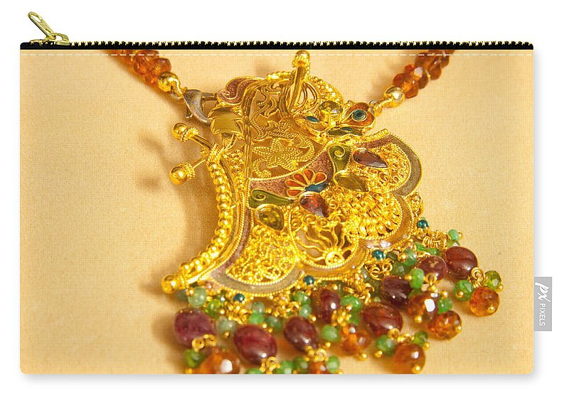 Jewel Carry-all Pouch featuring the photograph A Beautiful Intricately Carved Gold Pendant Hanging From A Semi-precious Stone Chain by Ashish Agarwal