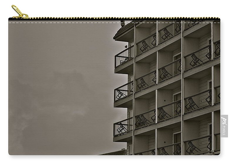 Hotel Carry-all Pouch featuring the photograph A Certain Order by Eric Tressler