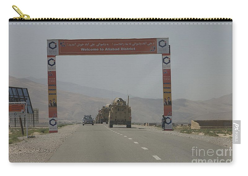 Afghanistan Carry-all Pouch featuring the photograph A Convoy Of Cougar Mraps Driving by Terry Moore