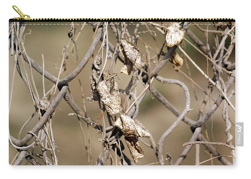 Fence Carry-all Pouch featuring the photograph A Cross-link Fence Along With Old Leaves At The Delhi Zoo by Ashish Agarwal