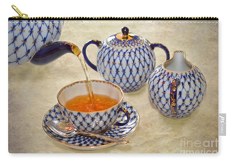 Tea Carry-all Pouch featuring the photograph A Cup Of Tea Tea Being Poured Into A China Cup by Louise Heusinkveld