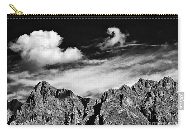 Alps Carry-all Pouch featuring the photograph A Curl In The Sky by Silvia Ganora