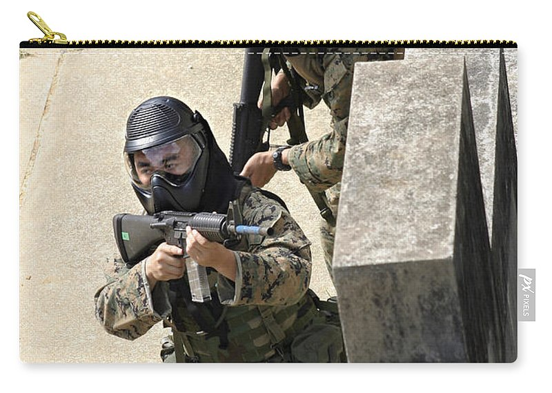 Adults Only Carry-all Pouch featuring the photograph A Fire Team Returns Fire From A Balcony by Stocktrek Images
