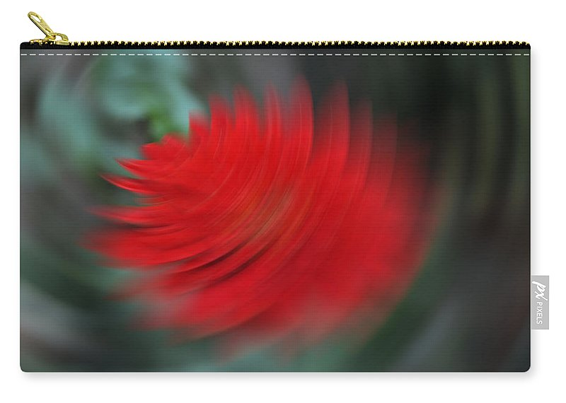 Flower Carry-all Pouch featuring the photograph A Flower Spinning In A Tornado Like Effect by Ashish Agarwal
