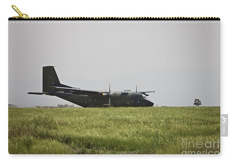 Propeller Carry-all Pouch featuring the photograph A German Air Force Transall C-160 Taxis by Terry Moore