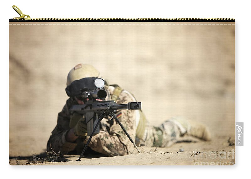 Army Carry-all Pouch featuring the photograph A German Soldier Sights In A Barrett by Terry Moore