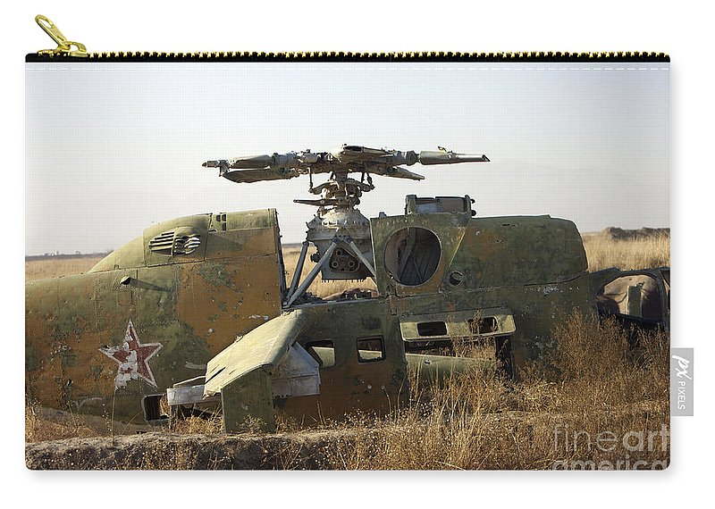Russian Carry-all Pouch featuring the photograph A Mi-35 Attack Helicopter At Kunduz Air by Terry Moore