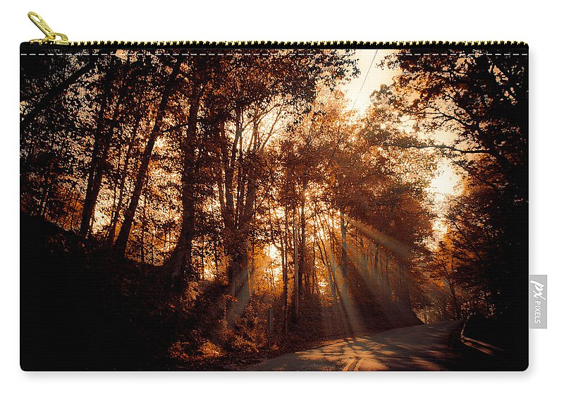 Ray Carry-all Pouch featuring the photograph A New Dawn by Trish Tritz