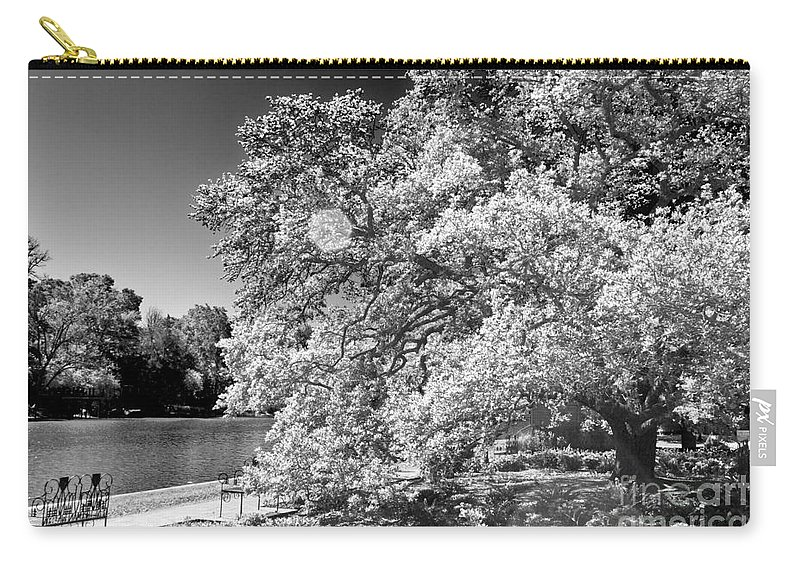 River Carry-all Pouch featuring the photograph A Seat By The Water by Ken Frischkorn