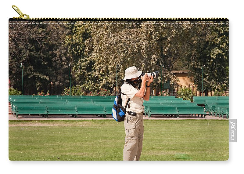 New Delhi Carry-all Pouch featuring the photograph A Tourist Using A High Powered Camera Inside The Red Court In New Delhi by Ashish Agarwal