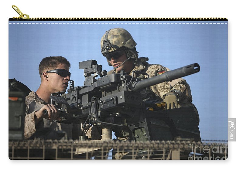 Afghanistan Carry-all Pouch featuring the photograph A U.s. Marine Fires A Gmg Automatic by Terry Moore