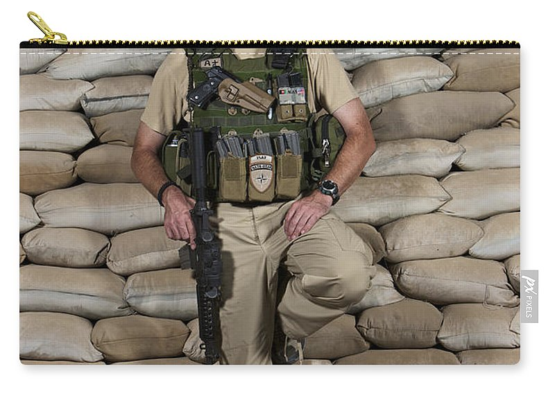 Operation Enduring Freedom Carry-all Pouch featuring the photograph A U.s. Police Officer Contractor Leans by Terry Moore
