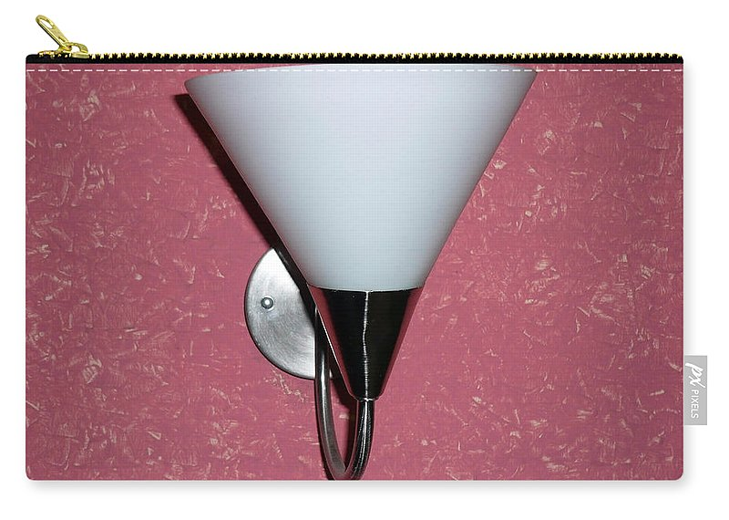 White Carry-all Pouch featuring the photograph A Wall Mounted Lamp Set Against A Pink Printed Wall Color by Ashish Agarwal