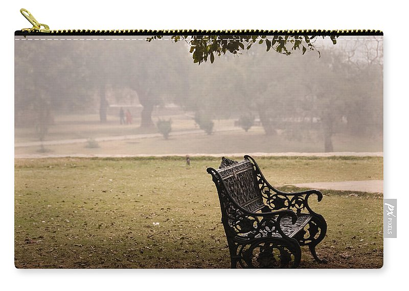 Bench Carry-all Pouch featuring the photograph A Wrought Iron Black Metal Bench Under A Tree In The Qutub Minar Compound by Ashish Agarwal