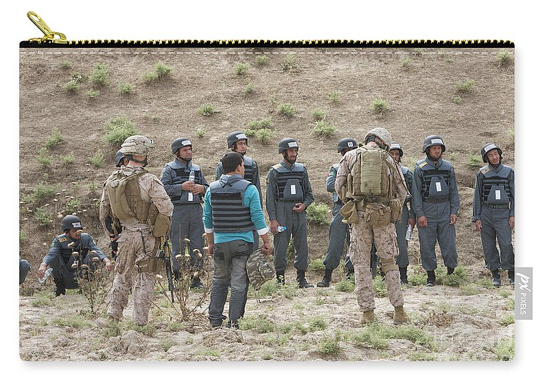 Us Marines Carry-all Pouch featuring the photograph Afghan Police Students Listen To U.s by Terry Moore