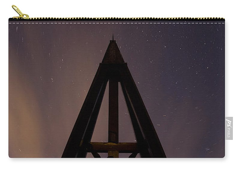 Startrails Carry-all Pouch featuring the photograph Against The Stars by Ian Middleton