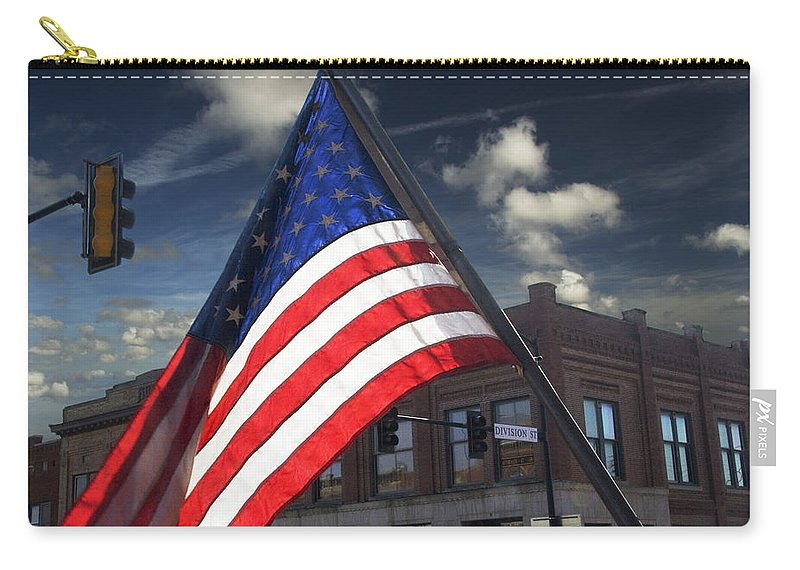 Art Carry-all Pouch featuring the photograph American Flag Flowing In Urban Landscape by Randall Nyhof