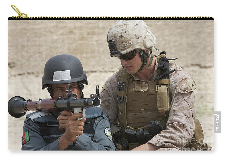 Soldier Carry-all Pouch featuring the photograph An Afghan Police Student Aiming A Rpg-7 by Terry Moore