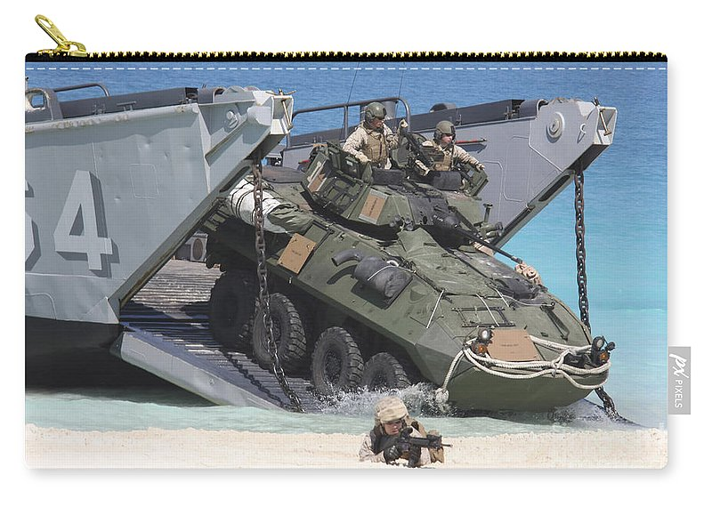 An Lav-25 Exits A Landing Craft Utility Carry-all Pouch