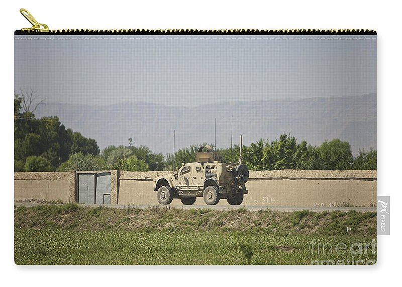 Afghanistan Carry-all Pouch featuring the photograph An M-atv Driving Towards Aliabad by Terry Moore