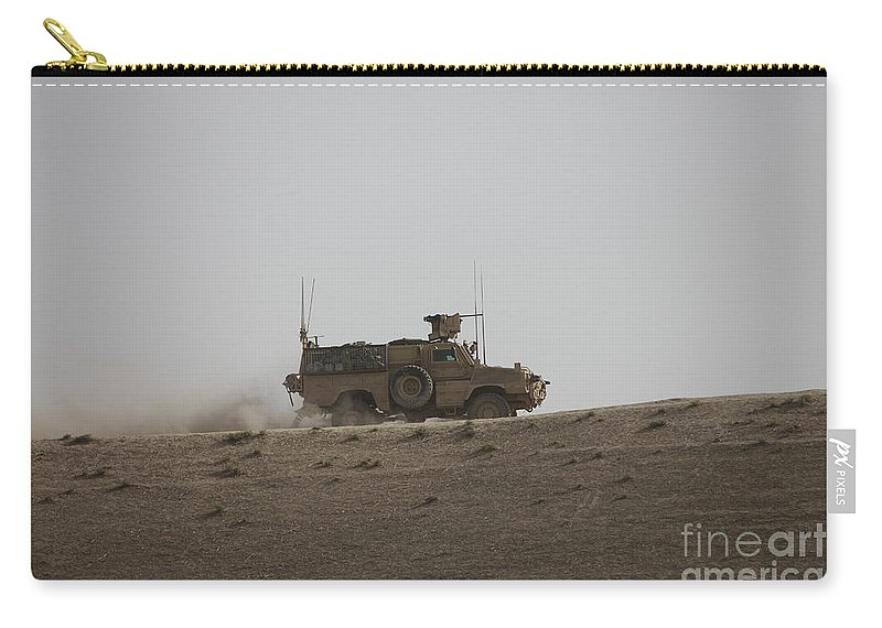 Operation Enduring Freedom Carry-all Pouch featuring the photograph An Mrap Vehicle Patrols The Ridge by Terry Moore