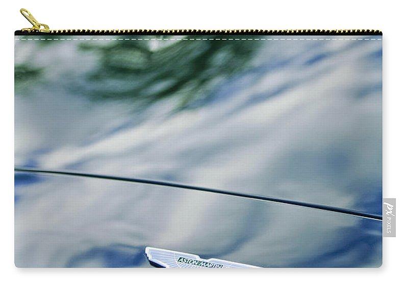 Aston Martin Carry-all Pouch featuring the photograph Aston Martin Hood Emblem 3 by Jill Reger