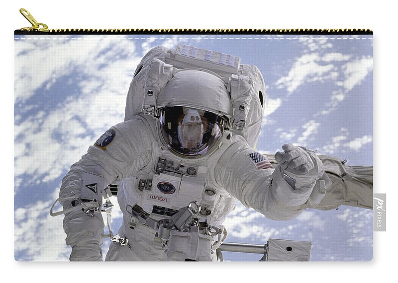 Sts-69 Carry-all Pouch featuring the photograph Astronaut Gernhardt On Robot Arm by Nasa