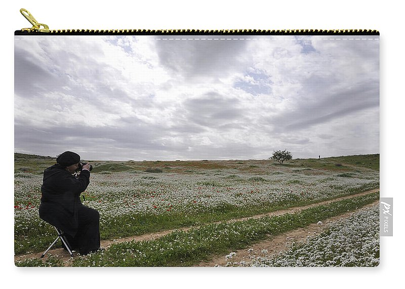 At Lachish Anemone Fields Carry-all Pouch featuring the photograph At Lachish Anemone Fields by Dubi Roman