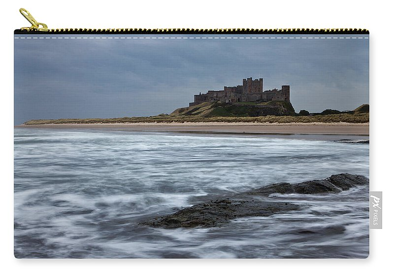 Bamburgh Carry-all Pouch featuring the photograph Bamburgh Castle by David Pringle