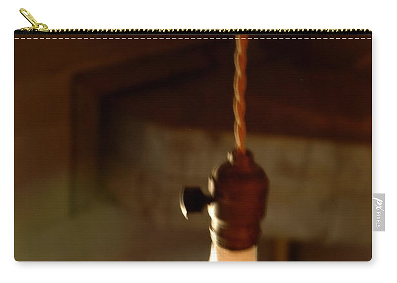 Usa Carry-all Pouch featuring the photograph Bare Bulb Swinging by LeeAnn McLaneGoetz McLaneGoetzStudioLLCcom
